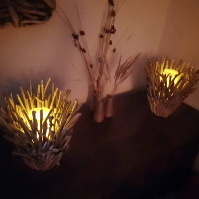 Pair of driftwood candle holders at night